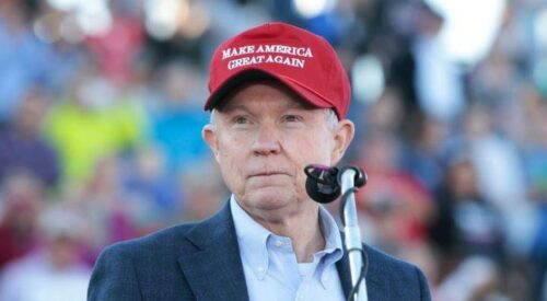 Jess Sessions w MAGA hat on